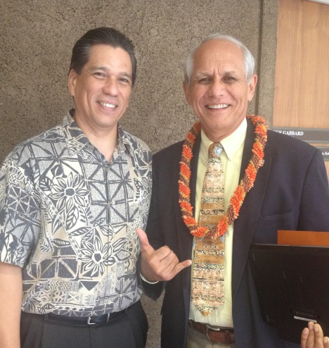 Alex Santiago (left), Partners in Development's Legislative Liaison, chatted with Senator Mike Gabbard after the rally.
