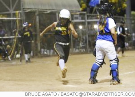 Star-Advertiser: Nanakuli's Chyanne Koko comes in to score a run in the 7th inning of the OIA White Division Softball Championship with Kaiser facing Nanakuli at the Central Oahu Regional Park.