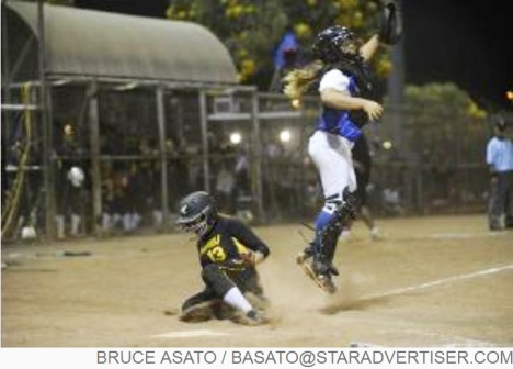 Star-Advertiser: Nanakuli's Kelcie DeFreitas scores a run after the throw got past the Kaiser catcher in the 7th inning of the OIA White Division Softball Championship with Kaiser facing Nanakuli at the Central Oahu Regional Park.