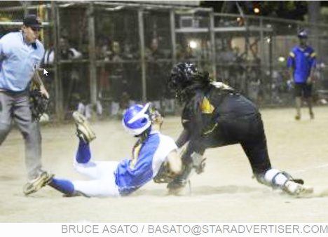 Star-Advertiser: Nanakuli's catcher Precious Paulo-Meyers tags Kaiser's Na Pua (Tess) Ho trying to score at home for the final out of the OIA White Division Softball Championship, with Nanakuli beating Kaiser at the Central Oahu Regional Park.
