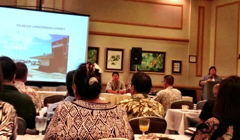 Tesha Malama (at right), addresses the audience to open the 2013 Kalaeloa Landowners' Summit held at Hale Ikena, Fort Shafter.