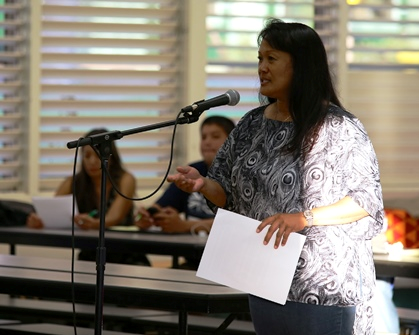 OHA beneficiary Joelle Aoki speaks at community meeting on Lāna'i about an ongoing need to help some Hawaiian families on the Neighbor Islands prosper and thrive.