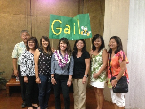 Leihoku Elementary principal Randall Miura (far left) and other Leihoku staff came to congratulate their SSC, Gail Nakao (with lei)