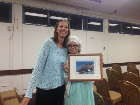 "Marcy Thomas and her daughter, Kainani Highland, whose photo, ""Ocean's Story on the Rocks"" is featured in the month of April 2014."
