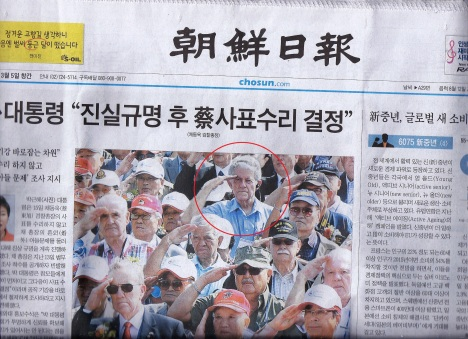 Brooks Outland, of Maili, with fellow American and Korean veterans of the Inchon Invasion, on the front page of Korea, the largest newspaper in the country.
