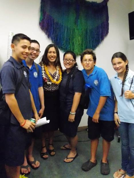 Kamehameha Schools students participated in the ku'i kalo (poi pounding) at the Capitol on Opening Day.  L-R: Isaiah Sabey, Mikah Bertelmann, Sen. Shimabukuro, Hi'ilani Fujihara-Nagamine, Hulukoa Nunokawa, Kahulu Nunokawa.  Hi'ilani is from the Wai'anae Coast.