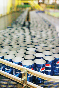 CINDY ELLEN RUSSELL / CRUSSELL@STARBULLETIN.COM Pepsi Co. cans are run through assembly machinery at the Kapolei Ball Corp. plant earlier this month.