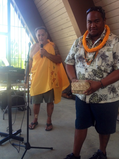 Hanalei Hopfe presented tapa stamps to Captain Kaina Holomalia.