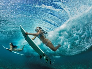 Photograph by Paul Nicklen Best friends Ha'a Keaulana, at right, and Maili Makana dive under a wave on their way to a surfing spot near their hometown of Makaha. Like generations before them, they visit these waters almost every day to refresh both body and spirit.