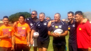 Rugby delegation poses with After School All Stars program managers.