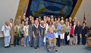 The Hawai'i State Senate with 12 of the 13 living crewmembers of the Hōkūleʻa's maiden voyage. Crew members (in lei), from left to right:  Francis Lee, Nainoa Thompson, Penny Martin, Kimo Lyman, Billy Richards, Snake Ah Hee, John