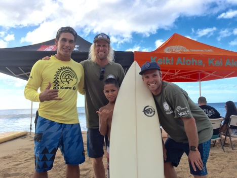 "Downing Hawaii donated a surfboard to ""Ray Ray"" Senensi, who won in his division. Duane DeSoto of Na Kama Kai (far left), posed with Ray Ray and the Gudauskus Brothers, from the Positive Vibe Warriors Foundation."