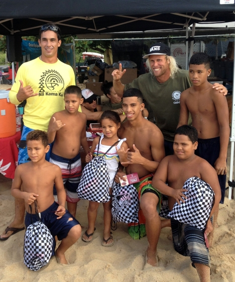 Duane DeSoto of Na Kama Kai (standing, far left) and Dane Gudauskus from the Positive Vibe Warriors Foundation (wearing hat), posed with Ray Ray Senensi and his Ohana at the Stoke-O-Rama contest. Vans generously donated goodie bags for all participants.