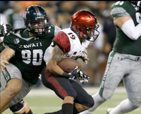 Kennedy Tulimasealii, University of Hawai'i all-Mountain West defensive lineman, closing in on one of his many quarterback sacks.