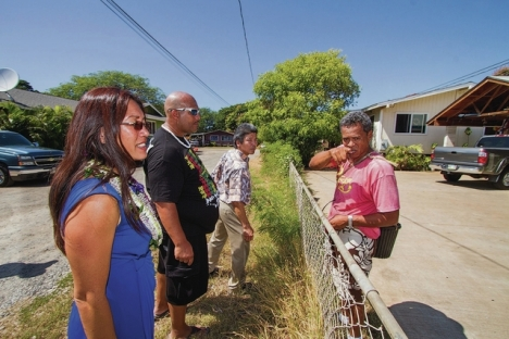 DENNIS ODA / DODA@STARADVERTISER.COM State Sen. Maile Shimabukuro toured the potential site of an extension of the Waianae Coast Emergency Access Route on Friday. Shimabukuro, left, talked with resident David Lopes, far right, about the possibility of a bypass road next to his property. Also pictured are resident Demott Conner, in the black shirt, and Jeffrey Fujimoto, an engineer with the Department of Hawaiian Home Lands.